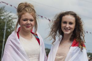 Friends Lauren Grace, left and Chloe Downey, await the Apprentice Boys 324th Annual Commemoration, at Irish Street Derry, on Saturday 10th August 2013.