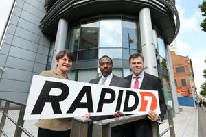 Minister Arlene Foster and Invest NI Alastair Hamilton are pictured with Corey Thomas of Rapid7. Pic Kelvin Boyes
