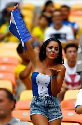 The beautiful game - football fans from around the world -  A Honduras fan shows hher support prior to the 2014 FIFA World Cup Brazil Group E match between Honduras and Switzerland at Arena Amazonia on June 25, 2014 in Manaus, Brazil.  (Photo by Matthew Lewis/Getty Images)