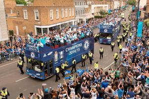Chelsea football club players take part in an open-top bus parade through Fulham, south-west London on May 25, 2015 to celebrate winning the Premier League title and the Capital One cup. AFP PHOTO / LEON NEALLEON NEAL/AFP/Getty Images