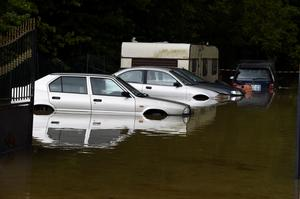 Submerged cars are pictured in a flooded street on June 1, 2016 in Nemours, southeast of Paris. Torrential downpours have lashed parts of northern Europe in recent days, leaving four dead in Germany, breaching the banks of the Seine in Paris and flooding rural roads and villages.  AFP PHOTO / DOMINIQUE FAGETDOMINIQUE FAGET/AFP/Getty Images