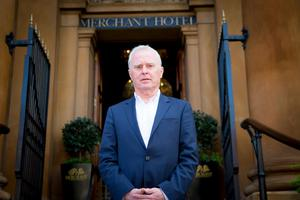 Beannchor Managing Director Bill Wolsey on the steps of the group's flagship Merchant Hotel in Belfast.