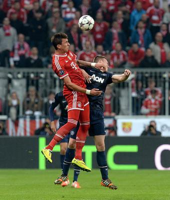 Bayern Munich's Mario Mandzukic (left) and Manchester United's Phil Jones battle for the ball during the Champions League, Quarter Final, Second Leg at the Allianz Arena, Munich, Germany.