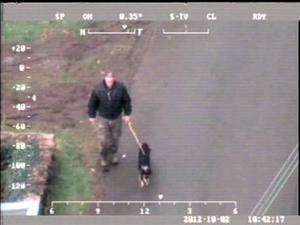 Handout CCTV still issued by Dyfed Powys Police of Mark Bridger with his dog in Ceinws, Mid Wales during the search for April Jones. Bridger has been found guilty of abducting and murdering schoolgirl April Jones