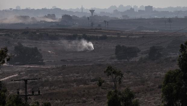 Smoke pours out of the ground due to an alleged campaign by the Israeli military to fill tunnels originating in Gaza with smoke to discover entrances into Israel on July 23, 2014 near Sderot, Israel.  (Photo by Andrew Burton/Getty Images)