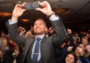 PACEMAKER BELFAST 18/11/2015 World Champion Carl Frampton takes a selfie with his fans  during a Press Conference at the Europa Hotel in Belfast on Wednesday, ahead of the super-bantamweight title fight in Manchester on the 27th February. Photo Colm Lenaghan/Pacemaker Press
