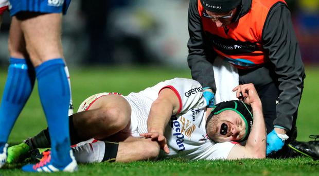 Agony: Ulster's Angus Curtis receives treatment before being hospitalised after a collision at the RDS on Friday night