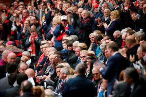 LIVERPOOL, ENGLAND - APRIL 15:  Liverpool FC supporters applaud during a memorial service to mark the 27th anniversary of the Hillsborough disaster, at Anfield stadium on April 15, 2016 in Liverpool, England. Thousands of fans, friends and relatives took part in the final Anfield memorial service for the 96 victims of the Hillsborough disaster. Earlier this year relatives of the victims agreed that this year's service would be the last. Bells across the City of Liverpool rang out during a one minute silence in memory of the 96 Liverpool supporters who lost their lives during a crush at an FA Cup semi-final match against Nottingham Forest at the Hillsborough football ground in Sheffield, South Yorkshire in 1989.  (Photo by Christopher Furlong/Getty Images)
