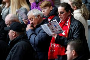 Members of the crowd during the last memorial service to be held at Anfield, Liverpool, to mark 27 years to the day since the tragedy claimed 96 lives. PRESS ASSOCIATION Photo. Picture date: Friday April 15, 2016. The 96 Liverpool fans died in the crush on the Leppings Lane terraces at Sheffield Wednesday's Hillsborough stadium after going to see their team play Nottingham Forest in an FA Cup semi-final on April 15, 1989. See PA story MEMORIAL Hillsborough. Photo credit should read: Peter Byrne/PA Wire