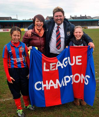 Going up: Niall Currie with (from left) daughter Lauren, wife Julie and daughter Ellie after Ards' promotion in 2013
