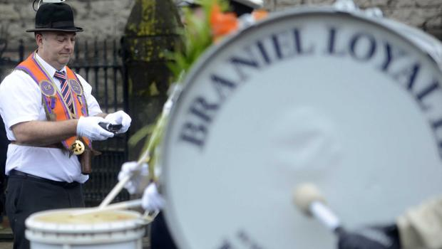 PACEMAKER BELFAST  13/07/2015 Recording the Bands  Men  during  The 12th of July Parades Belfast City on Monday  to commemorate protestant King William of Orange's victory over Catholic King James II at the Battle of the Boyne in 1690. Photo Colm Lenaghan/Pacemaker Press