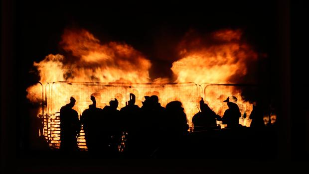 People attend an 11th night Bonfire in the Sandy Row area of Belfast.  Pic: Niall Carson/PA Wire