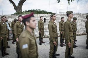 Israeli Honour Guard waiting for arrivel of the coffin of Sergeant Banaya Rubel during his funeral on July 20, 2014 in Holon, Israel. Sergeant Rubel was killed along with another IDF soldier on the twelfth day of operation 'Protective Edge,' when Hamas militants infiltrated Israel from a tunnel dug from Gaza and engaged Israeli soldiers.  (Photo by Ilia Yefimovich/Getty Images)