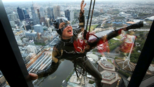 Stuntwoman Rowena Davies scales the outside of the Eureka Tower dressed as Catwoman at Eureka Skydeck on October 15, 2014 in Melbourne, Australia.  (Photo by Graham Denholm/Getty Images)