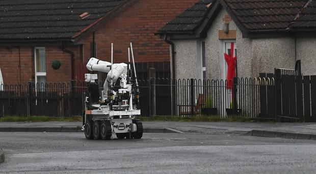 Police and ATO at the scene of a security alert in the White Rise area of Dunmurry on Thursday, following the discovery of a suspicious object. Photo Colm Lenaghan/ Pacemaker Press