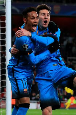 Barcelona's Lionel Messi (right) celebrates with teammate  Neymar after scoring his sides first goal of the game during the UEFA Champions League match at the Emirates Stadium, London. PRESS ASSOCIATION Photo. Picture date: Tuesday February 23, 2016. See PA story SOCCER Arsenal. Photo credit should read: Adam Davy/PA Wire