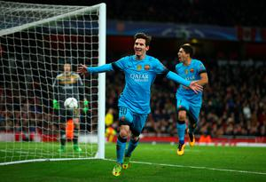 LONDON, ENGLAND - FEBRUARY 23:  Lionel Messi of Barcelona celebrates scoring his second goal  during the UEFA Champions League round of 16 first leg match between Arsenal and Barcelona on February 23, 2016 in London, United Kingdom.  (Photo by Paul Gilham/Getty Images)