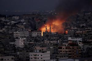 Smoke and flames from an Israeli strike rises over Gaza City, Thursday, July 24, 2014. (AP Photo/Adel Hana)