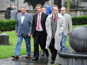 22.8.2013 PACEMAKER PRESS INTL. DUP members including Sammy Wilson and Edwin Poots arrive in support of fellow DUP councillor Ruth Patterson outside Belfast Laganside courts today. Patterson was in court facing charges relating to her Facebook comments regarding an imaginary attack on a republican parade in Castlederg. Picture Charles McQuillan/Pacemaker