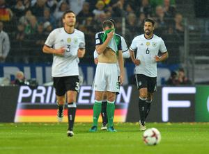 PACEMAKER BELFAST   11/10/2016 Northern Ireland v Germany World Cup Qualifier Group C A dejected Jonny Evans as  Germany's Sami Khedira scores  during this evenings game at the HDI Arena Hannover. Photo Colm Lenaghan/Pacemaker Press