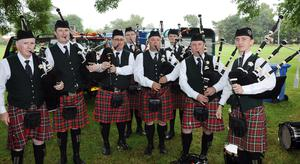 PACEMAKER BELFAST  13/07/2015 12th July celebrations in Derriaght/Dunmurry today Members of Harry Ferguson Memorial Pipe band warm up before departing for Dunmurry