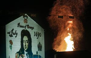 Picture - Kevin Scott / Presseye  Belfast - Northern Ireland - Saturday 11th July 2015 -  12th Night Bonfires  Pictured is the Donegall Road bonfire in South Belfast, as seen from the King Billy mural in sandy row as the 12th of July celebrations get under way across Northern Ireland to mark the victory of King William over King James   Picture by Kevin Scott  / Presseye.