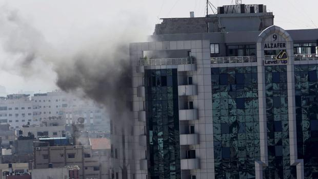 Smoke rises from Al Zafer tower apartment damaged by an Israeli strike in Gaza City in the northern Gaza Strip on Wednesday, July 30, 2014. (AP Photo/Adel Hana)