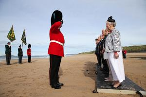 Press Eye - Belfast - Northern Ireland - 4th September 2016 -    Members of the British Legion along with Joan Christie, Her Majesty's Lord-Lieutenant for the County of Antrim take part in a Poppy Drop ceremony on the East Strand Beach during the Air Waves Portrush, Northern Ireland International Airshow. Organised by Causeway Coast and Glens Borough Council, over 100,000 spectators descended upon PortrushÕs eastern shoreline for two days of flying displays by some of the worldÕs most famous aviation attractions.  Photo by Kelvin Boyes / Press Eye