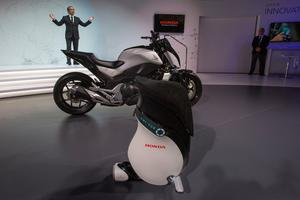 Yoshiyuki Matsumoto, President of Honda R and D Company, presents the new Uni Cub robot and Riding Assist concept motorcycle during CES at the Las Vegas Convention Center in Las Vegas, Nevada on January 5, 2017.   / AFP PHOTO / DAVID MCNEWDAVID MCNEW/AFP/Getty Images