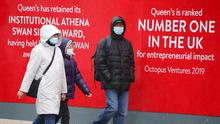 People pictured outside Queen's University in Belfast wearing face masks due to COVID-19. Credit: Jonathan Porter/PressEye