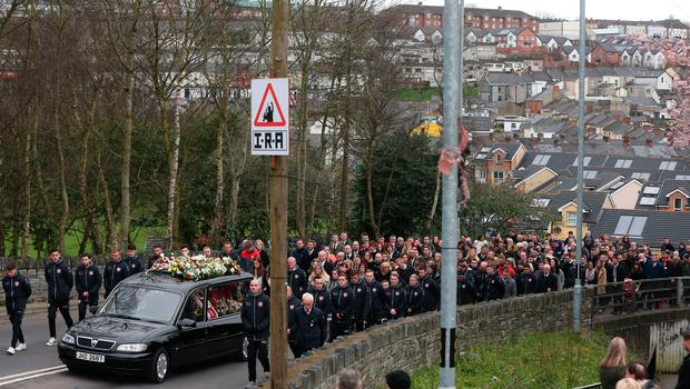The funeral cortege of Derry City football captain Ryan McBride travels to the Long Tower church in Londonderry, he was found dead at home on Sunday night aged 27.  Niall Carson/PA Wire