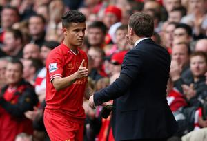 Liverpool Manager Brendan Rodgers congratulates Philippe Coutinho as he is substituted during the Barclays Premier League match between Liverpool and Manchester City at Anfield on April 13, 2014 in Liverpool, England.  (Photo by Alex Livesey/Getty Images)