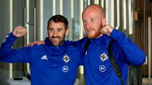 Striking success: goal hero Niall McGinn (left) and penalty shoot-out clincher Liam Boyce pictured as they left Sarajevo yesterday