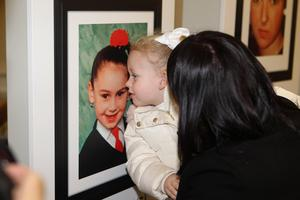 21/10/18 PACEMAKER PRESS An exhibition was opened to commerate the victims of the Shankill Bombing in the Methodist Church on the shankill Road. Isla McKee kisses a picture of her relative Michelle Baird. PICTURE MATT BOHILL PACEMAKER PRESS