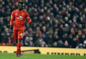 Liverpool's Italian striker Mario Balotelli gives a thumbs up after scoring Liverpool's third goal during the English Premier League football match between Liverpool and Tottenham Hotspur at the Anfield stadium.