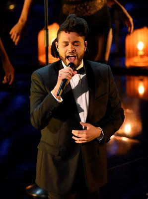 Singer The Weeknd performs on stage at the 88th Oscars on February 28, 2016 in Hollywood, California. AFP PHOTO / MARK RALSTONMARK RALSTON/AFP/Getty Images