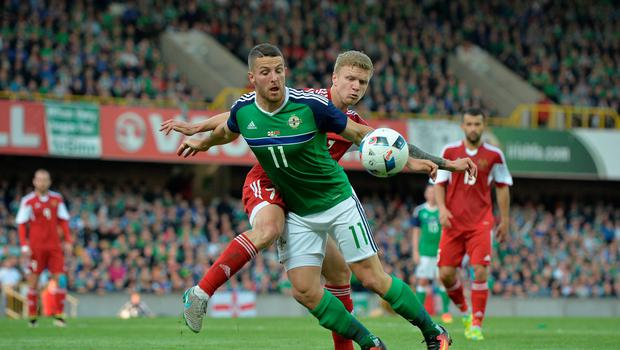 BELFAST, NORTHERN IRELAND - MAY 27: Conor Washington (L) of Northern Ireland and Mikita Korzun (R) of Belarus during the international friendly game between Northern Ireland and Belarus on May 26, 2016 in Belfast, Northern Ireland. (Photo by Charles McQuillan/Getty Images)