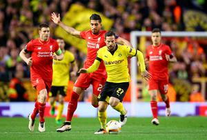 LIVERPOOL, ENGLAND - APRIL 14: Gonzalo Castro of Borussia Dortmund goes past Emre Can of Liverpool during the UEFA Europa League quarter final, second leg match between Liverpool and Borussia Dortmund at Anfield on April 14, 2016 in Liverpool, United Kingdom. (Photo by Clive Brunskill/Getty Images)