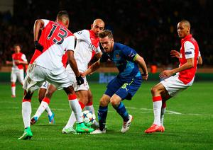 MONACO - MARCH 17:  Aaron Ramsey of Arsenal take son the Monaco defence during the UEFA Champions League round of 16 second leg match between AS Monaco and Arsenal at Stade Louis II on March 17, 2015 in Monaco, Monaco.  (Photo by Michael Steele/Getty Images)
