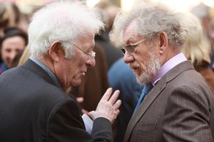 Seamus Heaney (L) talks with Sir Ian McKellen after attending a memorial service for actor Paul Scofield on March 19, 2009 in London