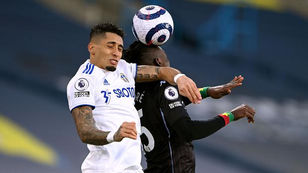 Raphinha and Bertrand Traore in an aerial battle for the ball (Laurence Griffiths/PA)