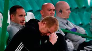 Down and out: Celtic manager Neil Lennon can't hide his feelings as his side tumbled out of the Champions League to Ferencvaros