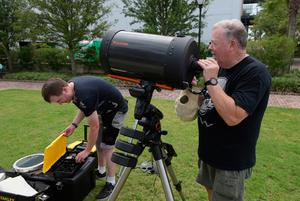 "Eric Colley (L) and his father Harvey Colley set up a telescope in Charleston, South Carolina, on the day of the total solar eclipse, on August 21, 2017. The Sun started to vanish behind the Moon as the partial phase of the so-called Great American Eclipse began Monday, with millions of eager sky-gazers soon to witness ""totality"" across the nation for the first time in nearly a century. / AFP PHOTO / MANDEL NGANMANDEL NGAN/AFP/Getty Images"