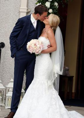 Manchester United footballer Jonny Evans and Helen McConnell kiss after their wedding at Clough Presbyterian Church, County Down. PRESS ASSOCIATION Photo. Picture date: Saturday June 1, 2013. See PA story SOCIAL Evans. Photo credit should read: Paul Faith/PA Wire