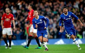 "Chelsea's Eden Hazard celebrate scoring his side's third goal of the game with teammate Diego Costa (right) during the Premier League match at Stamford Bridge, London. PRESS ASSOCIATION Photo. Picture date: Sunday October 23, 2016. See PA story SOCCER Chelsea. Photo credit should read: Nick Potts/PA Wire. RESTRICTIONS: EDITORIAL USE ONLY No use with unauthorised audio, video, data, fixture lists, club/league logos or ""live"" services. Online in-match use limited to 75 images, no video emulation. No use in betting, games or single club/league/player publications."