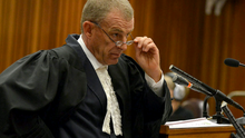 State prosecutor Gerrie Nel questions Oscar Pistorius during cross examination in the Pretoria High Court on April 14, 2014, in Pretoria, South Africa. (Photo by Antoine de Ras/Independent Newspapers/Gallo Images/Getty Images)