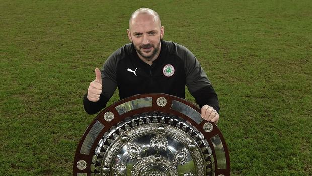 Paddy McLaughlin celebrates winning his first trophy as Cliftonville manager.
