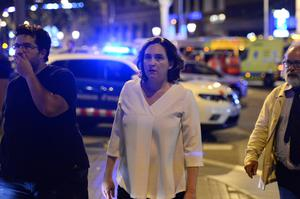 """Barcelona's Mayor Ada Colau (C) arrives on the Rambla boulevard after a van ploughed into the crowd, killing at least 13 people and injuring around 100 others on the Rambla in Barcelona on August 17, 2017. A driver deliberately rammed a van into a crowd on Barcelona's most popular street on August 17, 2017 killing at least 13 people before fleeing to a nearby bar, police said.  Officers in Spain's second-largest city said the ramming on Las Ramblas was a """"terrorist attack"""". The driver of a van that mowed into a packed street in Barcelona is still on the run, Spanish police said. / AFP PHOTO / Josep LAGOJOSEP LAGO/AFP/Getty Images"""