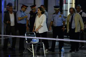 """Barcelona's Mayor Ada Colau (C) and officials arrive on the Rambla boulevard after a van ploughed into the crowd, killing at least 13 people and injuring around 100 others on the Rambla in Barcelona on August 17, 2017. A driver deliberately rammed a van into a crowd on Barcelona's most popular street on August 17, 2017 killing at least 13 people before fleeing to a nearby bar, police said.  Officers in Spain's second-largest city said the ramming on Las Ramblas was a """"terrorist attack"""". The driver of a van that mowed into a packed street in Barcelona is still on the run, Spanish police said. / AFP PHOTO / Josep LAGOJOSEP LAGO/AFP/Getty Images"""