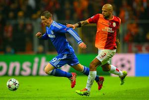 Fernando Torres of Chelsea and Felipe Melo of Galatasaray battle for the ball during the UEFA Champions League Round of 16 first leg match between Galatasaray AS and Chelsea at Ali Sami Yen Arena on February 26, 2014 in Istanbul, Turkey.  (Photo by Michael Regan/Getty Images)